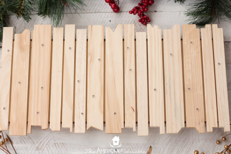 DIY Rustic Light-Up Christmas Sign - A Beautiful and Easy-to-make piece of Christmas decor. Make this to decorate your own home or give as a thoughtful gift!