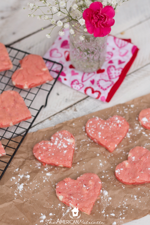 Strawberry Cake Mix Heart-Shaped Valentine Cookies - Incredibly easy to make and absolutely delicious! The perfect treat to make to celebrate Valentine's Day!