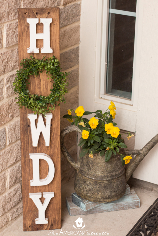 DIY Howdy Front Porch Pallet Sign with Interchangeable Seasonable Wreaths - easy and inexpensive DIY welcome sign you can keep up year-round! Just change out the wreath to celebrate various seasons!