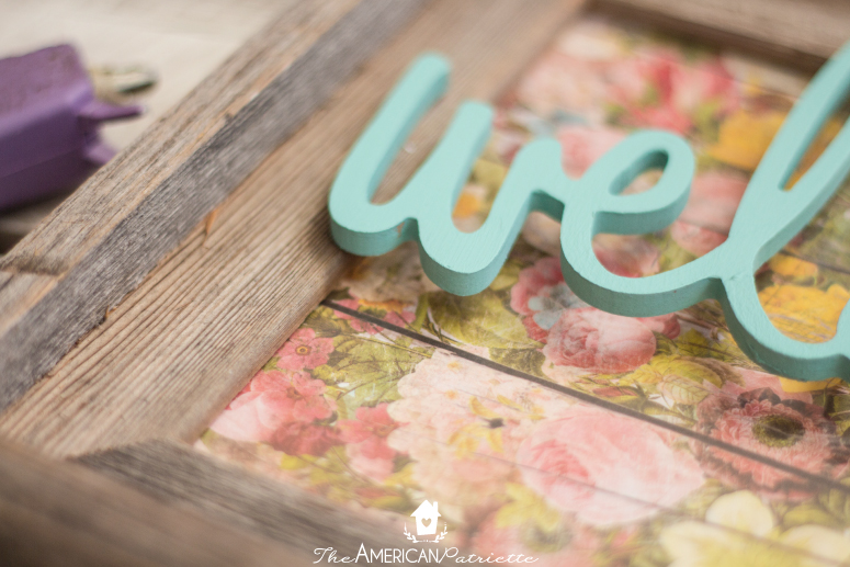 Colorful DIY Welcome Sign Using a Repurposed Frame - A super easy and ADORABLE DIY project that helps welcome guests into your home!