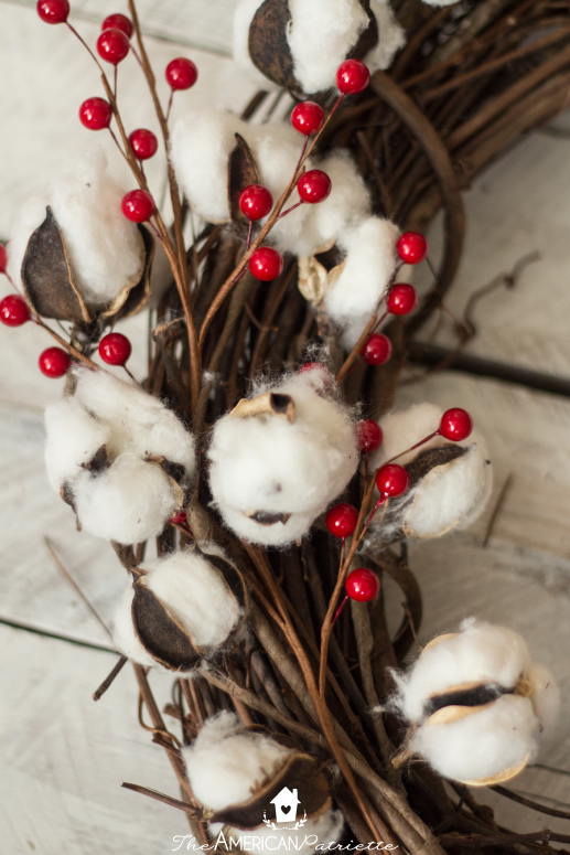 Farmhouse American Flag Wreath, complete with cotton boll stems and red berry stems. A beautiful, simple, rustic patriotic wreath to welcome your guests through your front door!